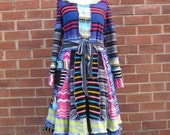 SALE Very very stripy elf coat with a sequinned bow upcycled by Niknok