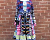 Very very stripy elf coat with a sequinned bow upcycled by Niknok