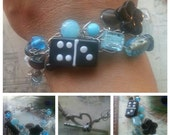 SALE. Wire Crocheted Bracelet with a bit of Domino Whimsy