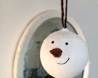 Hand painted snowman with a long carrot nose bauble