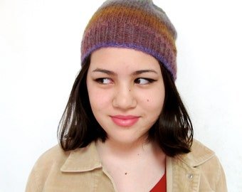 Slightly slouchy beanie in purple,amber, and green mix colors
