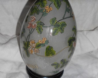 Chinoiserie reversed painted flowers in a glass egg with wood stand
