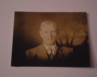"""Vintage B&W photo of distinguished gentleman in suit and tie. Unique shadow photo with """"trees"""" in background"""