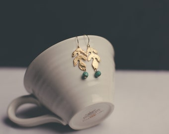 Matte gold leaf earrings with turquoise bead