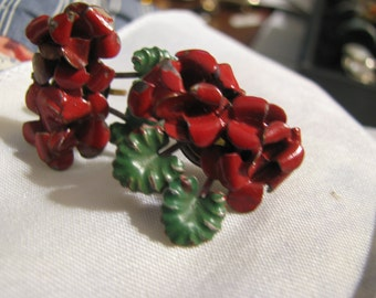 MARKED GERMANY 1920s or 30s pot metal figural folded flower screw on earrings in  red and green enamels.  1.25 inches each