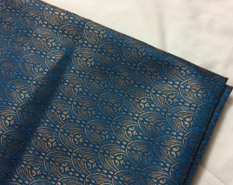 One yard  of Indian silk brocade in blue and gold in an elegant design