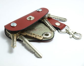 Extremely convenient keychain key holder from red patent leather. Holds 6-8 regular keys, great gift idea, unique gift
