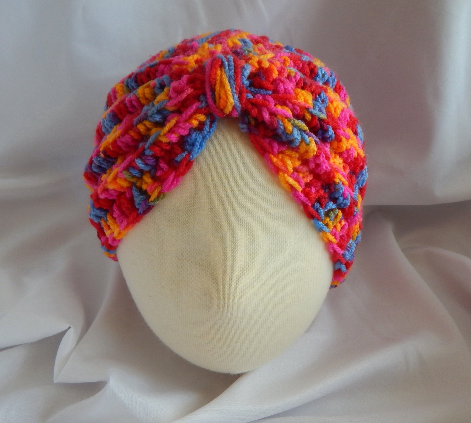Crochet baby turban hat pattern manet for baby turban hat crochet in bright pink blue red 3 to 6 baditri Images