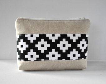 Woman's linen padded travel bag black and white cross modern print panel cosmetics make up pouch.