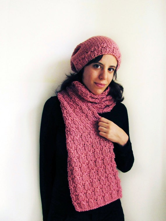 Pink handknit scarf and slouchy hat set.