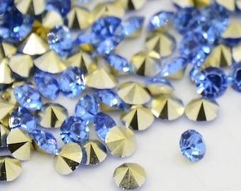 24 rhinestones SS23, resin, Ø5mm, light sapphire, light blue