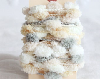 Pom Pom garland in light neutrals 6 yards- pretty puffs of cream, grey and white on a knitted cord