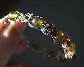 Blooming - green amber orange yellow garnet green tourmaline flowers silver filled wire wrapped bangle bracelet