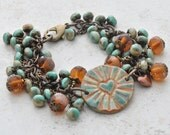 Radiating Heart Ceramic Bracelet with Trailing Handmade Topaz Lampwork Beads and Turquoise Czech Glass Beads