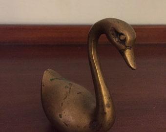Tiny brass swan figurine