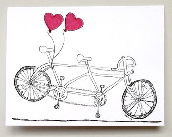 Tandem bicycle with heart balloons