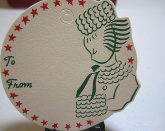 1940's-50's unused die cut christmas gift tag card graphics of victorian dressed lady holding a muff red stars