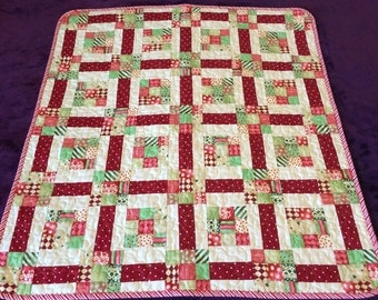"""Red, Green and Ultra Modern Are All Together In This 34.75"""" X 37.5""""  Quilt"""