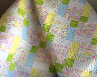 """A Pastel Delight In This 47"""" X 48"""" Quilt Done In The Scribbles Line By Windham Fabrics"""