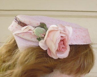 Pink straw pillbox hat with rose
