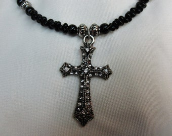 Sparkling Silver Cross Necklace set on Black Farfalle Beaded 16 and a half Inch Necklace with Sturdy Magnetic Clasp