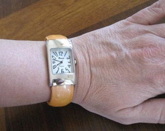 Vintage cuff watch with mother of pearl face.  Ladies watch.