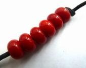 handmade lampwork glass beads, red orange spacers