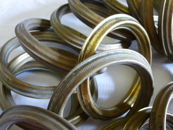 25 antique pressed brass or bronze curtain rings circa