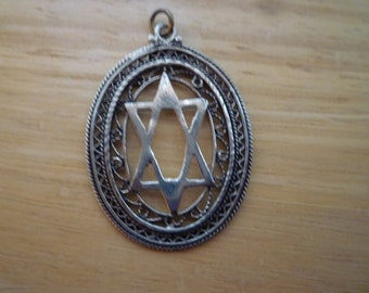 Judaica vintage Sterling Silver Star of David pendant in oval with filigree detail