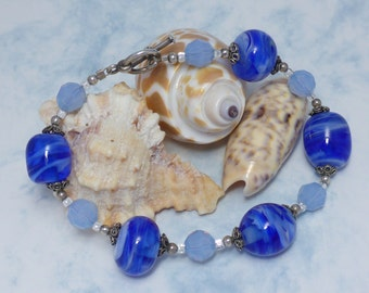 Bracelet with Blue and white swirled Glass Beads, Sterling Silver and blue crystals