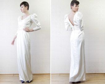 White satin long sleeve simple column open back wedding dress