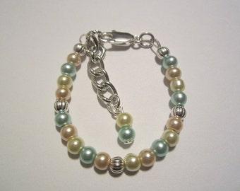 Newborn baby satin finished pearl bracelet.