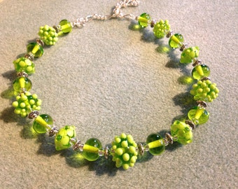Bright green lampwork glass necklace with bumps and flowers