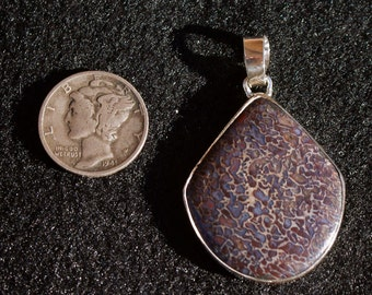 purple dinosaur bone pendant