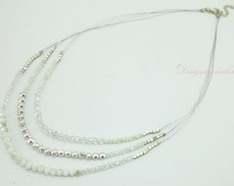 Clear crystal,silver beads on silk necklace.