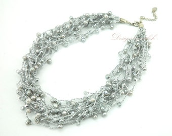 Grey freshwater pearl multi strand necklace.