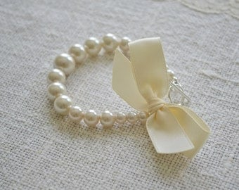 Eleanor Bracelet: Tapered Ivory Pearl Bridal Bracelet with Silver Toggle and Satin Bow