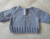 Baby boy or girl's light blue tweed short sleeved sweater