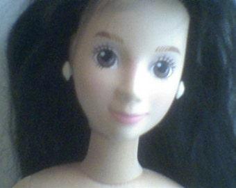 "A vintage Mattel 18"" hot looks child friendly plastic head cloth body doll"