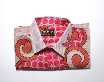 Mens shirt pink floral and geometric print on white base separate detailing inside collar. Short sleeves. Lightweight 100% cotton