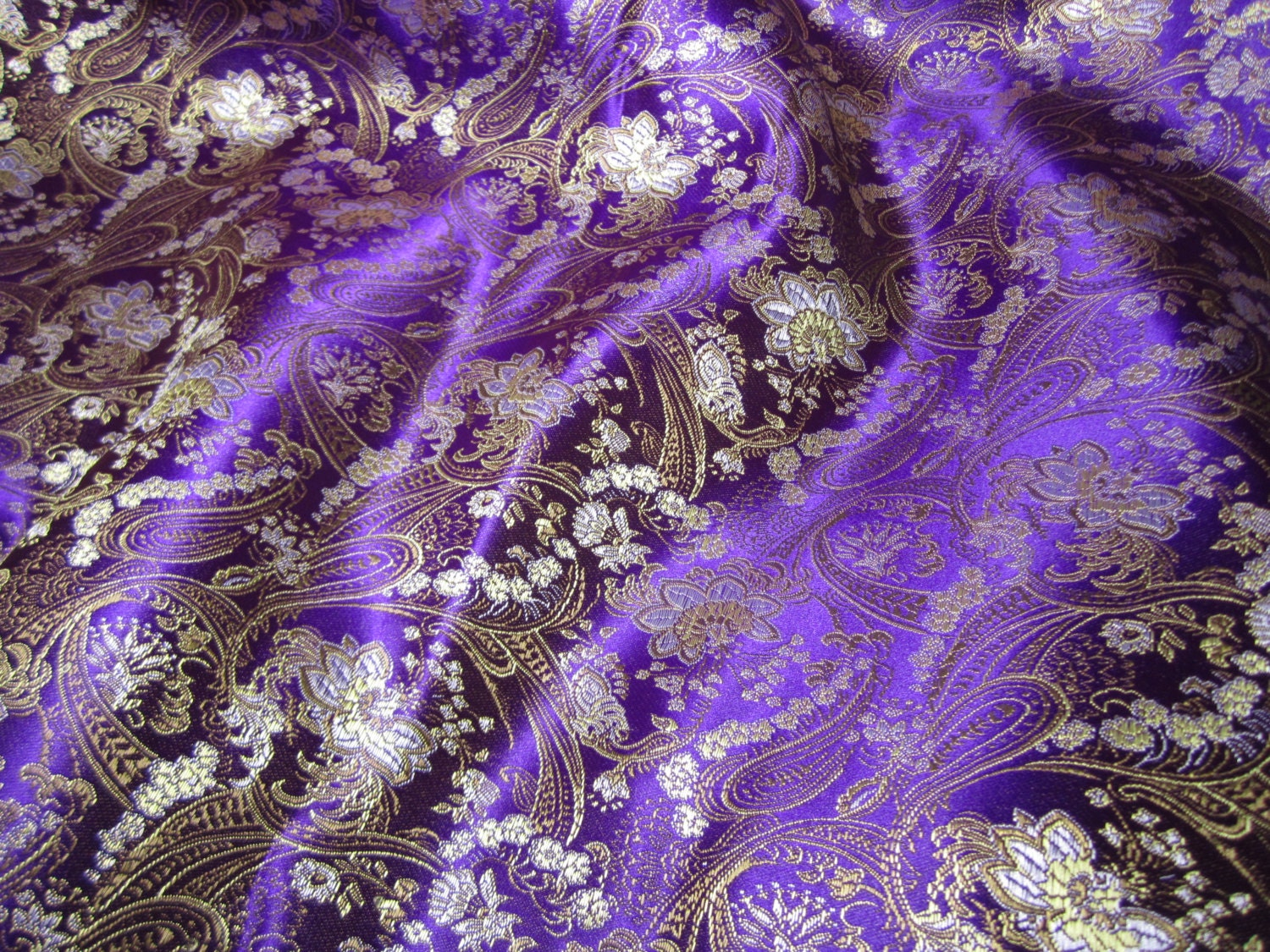 chinese brocade fabric in royal purple with a floral pattern