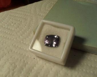 GIA CERTIFIED TANZANITE - Stunning 6.93 ct. Certified Natural Grayish Violet D-Block Cushion Cut Tanzanite...