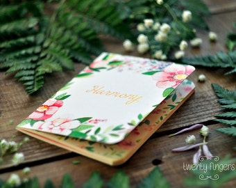 "Notebook with flower wreath watercolor illustration with golden word ""Harmony"" (small size)"
