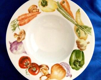 Handpainted vegetables on porcelain bowl