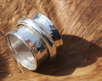 Wide band ,sterling silver spinner ring.