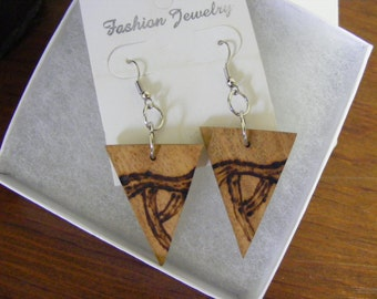 Natural, rustic wood earrings with a wood burned graphic design.