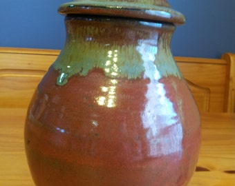 Red Lidded Storage Jar