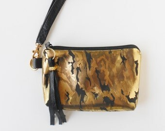 Leather wristlet or leather clutch in brilliant golden camouflage.