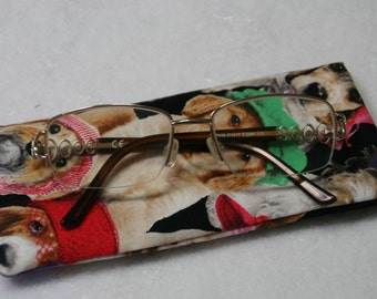 Bright colorful  eyeglass case featuring variety of dogs wearing hats