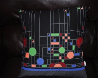 A pair of geometric Cushion Covers